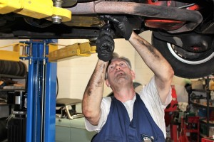 When we say, 'hands on', we mean it!  Bob working on the innards of his TransAm Firebird